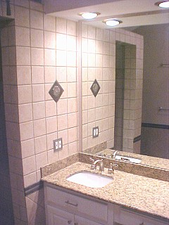 vanity with tile and medallion